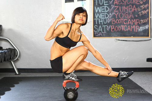 Edna holding herself up balancing on a kettlebell, she makes this look easy. commercial photographer - Michael Lagman Photography