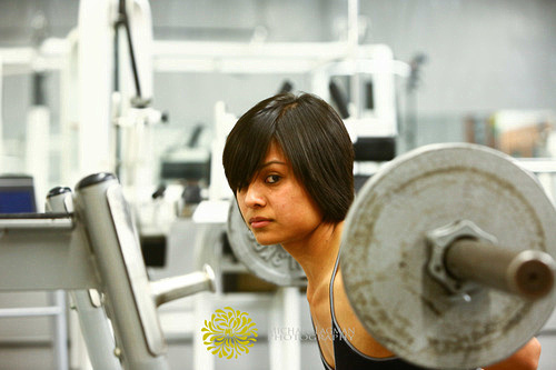 This is a great image we took of Edna as she is doing one of her squats in the gym. I love the intensity of the photo in this one.  Visit www.michaellagman.com for more info