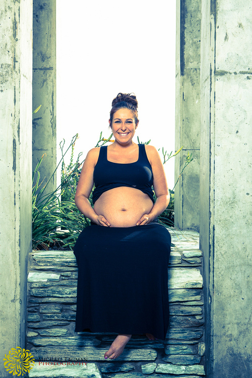 Another photo of Aly having fun with her maternity photo shoot in San Diego