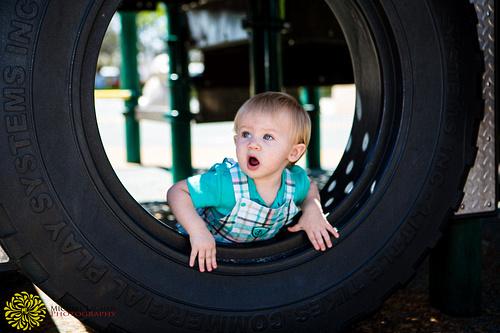 Gunnar playing in a big tire at Balboa Park